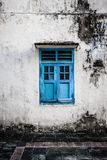 Blue wooden window and grunge wall Stock Image