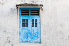 Blue wooden window and grunge wall Stock Photography