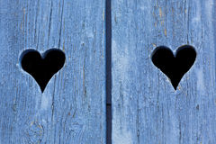 Blue wooden window shutters in France Stock Photos