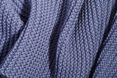 Blue wool knitted scarf. royalty free stock photography