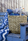 Blue wool and knitting needles royalty free stock photography