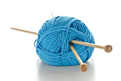 Blue wool with knitting needles Royalty Free Stock Photos