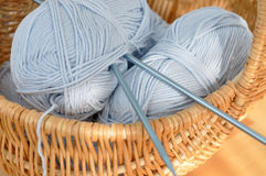 Blue Wool in a Wicker Basket Stock Images