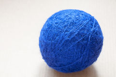Blue wool yarn skein on cardboard background Royalty Free Stock Photography