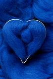 Blue woolen heart shape Stock Images