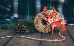 Blue woolen plaid and old-fashioned Christmas decorations royalty free stock image
