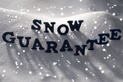 Blue Word Snow Guarantee, Snowflakes Royalty Free Stock Photos