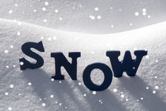 Blue Word Snow With Snowflakes Stock Image