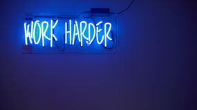 Blue Work Harder Neon Sign Royalty Free Stock Images
