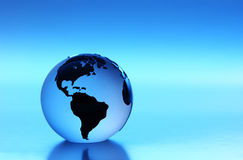 Blue World. Glass Globe with blue lighting Studio shot Royalty Free Stock Images