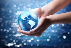 Blue world in the hand - Usa. With sea background stock photos