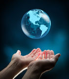 Blue world in hands. Background blue nature royalty free stock photography