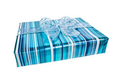 Blue wrapped gift box. Decorated with a blue organza bow Royalty Free Stock Image