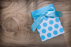 Blue wrapped present box on wooden board celebrations concept Royalty Free Stock Photo