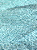 Blue wrapping paper with geometric hand drawn waves Stock Photos