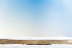 Blue xmas background space and table with snow.  Royalty Free Stock Photography