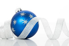 Blue xmas ball and silver ribbon on white background Royalty Free Stock Photos