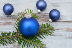 Blue xmas bauble and fir branch Royalty Free Stock Images
