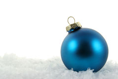 Blue Xmas Bauble in the Snow Royalty Free Stock Photo