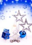 Blue xmas card. Santa figure , blue xmas balls and silver stars on snow Stock Image