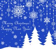 Blue xmas card. With firs and hanging baubles Royalty Free Stock Image