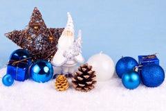 Blue xmas decoration. Christmas decoration - santa claus figure on blue background Royalty Free Stock Photos