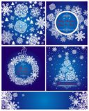 Blue xmas greeting cards with paper snowflakes Royalty Free Stock Photos