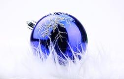 Blue xmas ornament on bright holiday Stock Photo