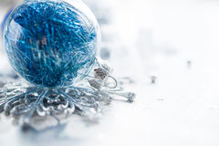 Blue xmas ornaments on bright holiday background Royalty Free Stock Photos