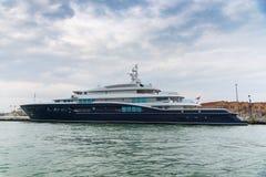 Blue Yacht at venice. Large luxury motor blue yacht docked in Venice, Italy Stock Photo
