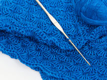 Blue yarn ball and crochet hook Royalty Free Stock Photography