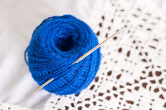 Blue yarn and crochet hook Stock Photo
