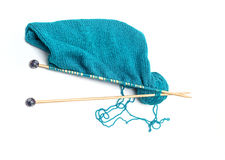 Blue yarn with knitted fabric and knitting needles Royalty Free Stock Photos