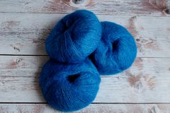 blue yarn for knitting on a light background stock photos