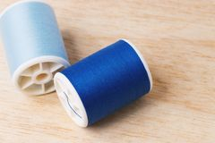 Blue yarns. Are on wooden boards Stock Images