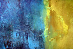 Blue and Yellow. Paint on Plaster Wall stock photos