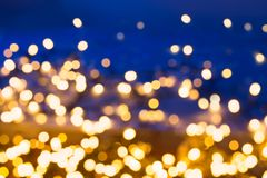 Blue and golden abstract bokeh background. The blue and yellow abstract bokeh background royalty free stock photo
