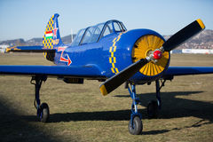 Blue and yellow air screw sport airplane Royalty Free Stock Photo