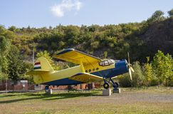 Blue yellow airplane with hungarian flag and landscape background. royalty free stock images