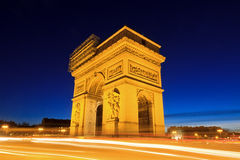 Blue and yellow Arc. Beautiful night view of the Arc de Triomphe in Paris, France Royalty Free Stock Images
