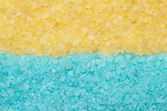 Blue and yellow aromatic bath salt background Stock Images