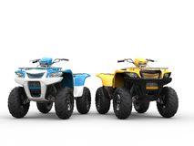 Blue and yellow ATVs Royalty Free Stock Images