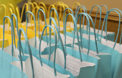 Blue and yellow bags. Blue and yellow paper bags handles Royalty Free Stock Photos