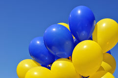 Blue and yellow balloons in the city festival Royalty Free Stock Photos