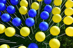 Blue and yellow balloons Stock Images
