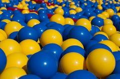 Blue and yellow balls closeup Stock Photos
