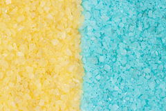 Blue and yellow bath salt background Stock Photography