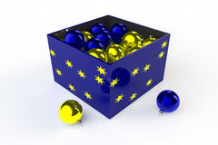 Blue and Yellow Baubles. A blue box with yellow stars containing blue and yellow Christmas baubles Royalty Free Stock Photo
