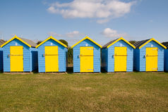 Blue and yellow beach huts Stock Photos
