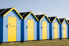 Blue and yellow beach huts Stock Photo